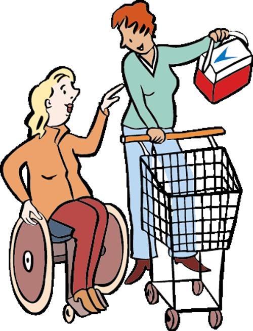 Eine Assistentin hilft einer Frau im Rollstuhl beim Einkaufen