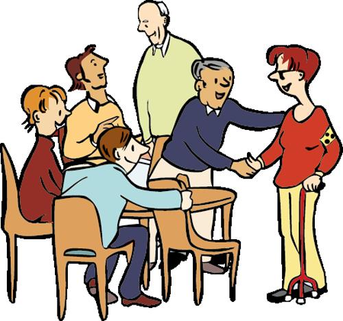 Eine Frau mit Sehbehinderung wird von der Arbeitsgruppe begrüßt